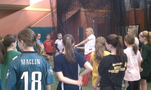 katelyn teaches hitting.JPG